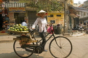 VIETNAM, Hanoi, ornage vendor with bicycle, VT571JPL