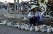 VIETNAM, Hoi An, Central Market, vendor selling ducks, VT403JPL