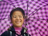 VIETNAM, Lao Cai province, Sapa, smiling Black Hmong woman under an umbrella, VT522JPL